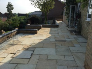 Fossil stone patio layed in Sutton