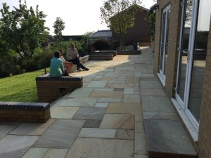 Fossil stone patio at the end of the grouting day