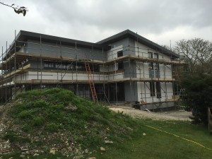 Sips new build with webber render and painted larch cladding